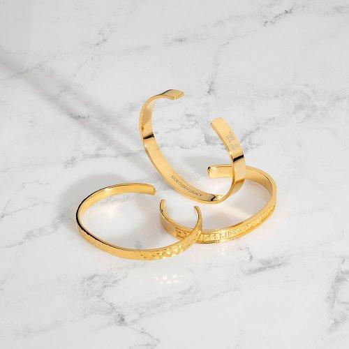 Gold tone bangles